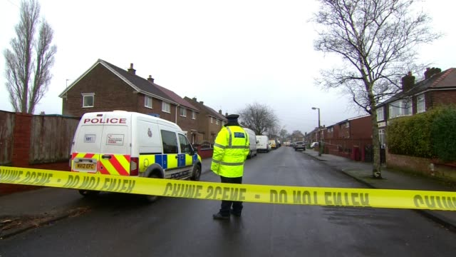 63yearold woman arrested on suspicion of murder after body dug up in garden ENGLAND Greater Manchester Reddish EXT Police and forensics officer...