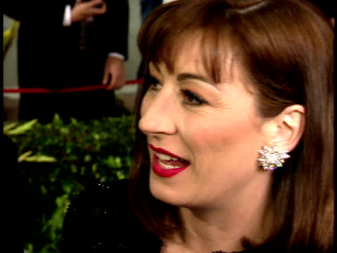 Anjelica Houston speaking to reporter on the red carpet won't say who she hopes will win