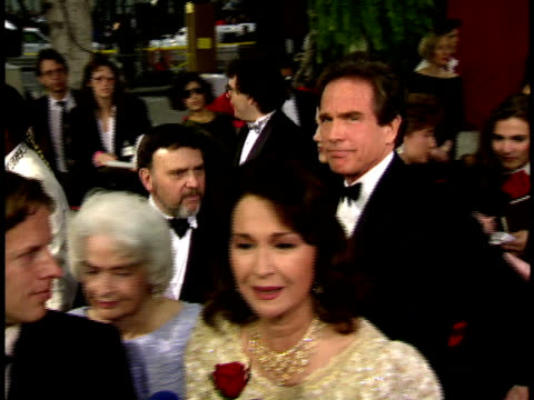 64th academy awards: annette bening and warren beatty walking on the red carpet behind diane ladd. - annette bening stock videos & royalty-free footage