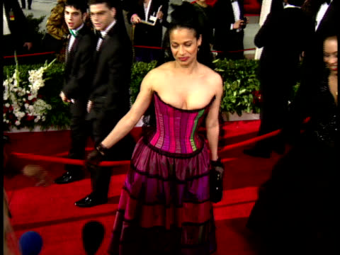 Debbie Allen showing designer dress turning in circle on the red carpet