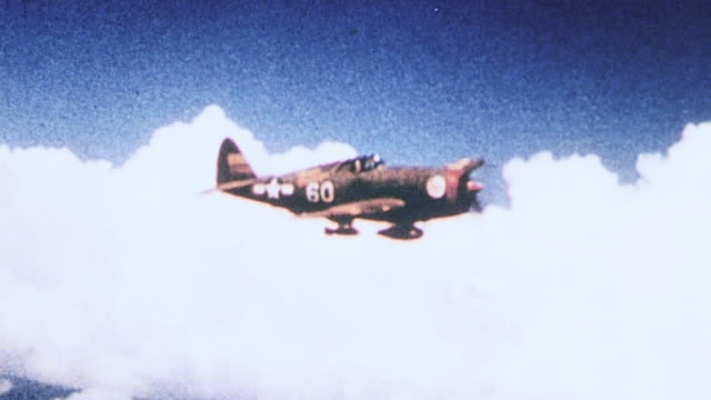 aerial 65th fighter squadron flying in formation with individual planes peeling off / corsica france - 1944 video stock e b–roll