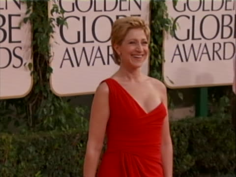 68th annual golden globes awards. she is wearing a one strap red gown. she is nominated for an emmy for lead actress in a comedy series for her role... - ナースジャッキー点の映像素材/bロール