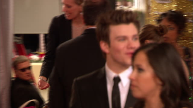 69th GOLDEN GLOBE AWARDS ARRIVALS HD CU Chris Colfer walking along the red carpet waving at the Beverly Hills Hilton