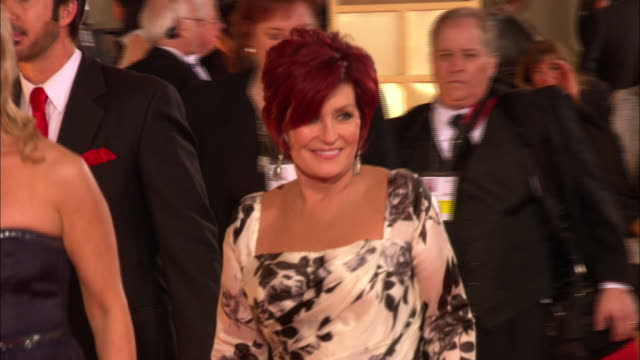 69th GOLDEN GLOBE AWARDS ARRIVALS HD MS/MCU Sharon Osbourne walking down the red carpet waving at the Beverly Hilton Hotel