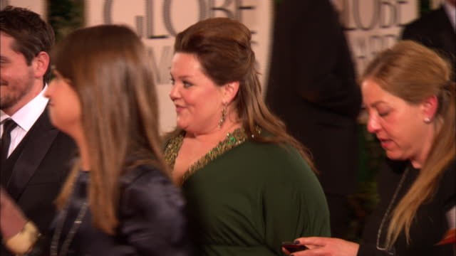 69th golden globe awards arrivals: hd: melissa mccarthy w/ husband ben falcone, smiles and waves as they walk down red carpet at the beverly hilton... - ben falcone stock videos & royalty-free footage