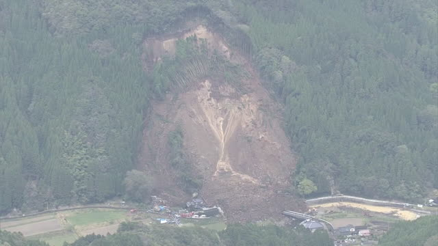 aerial shot long shot of the site of a massive landslide on april 11 in the city of nakatsu in oita prefecture / massive dirt and a mountain of... - oita city stock videos & royalty-free footage