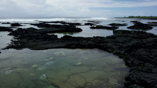 6k RED Low flying aerial over colorful tide pools