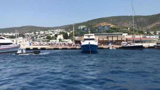 a ferry carrying 205 turkish citizens arrives at a coastal city of aegean province of mugla on july 21 2017 as they were stranded in greek island of... - mugla province stock videos and b-roll footage