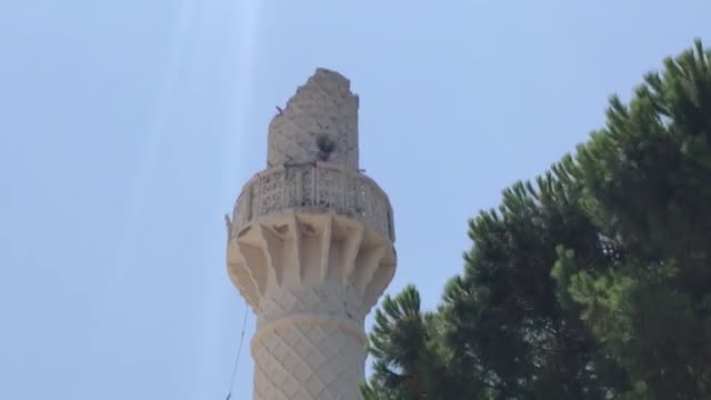 minaret of yahsi yali mosque collapsed in bodrum district of mugla western turkey after a magnitude65 earthquake hit the aegean sea near the turkish... - ruine stock-videos und b-roll-filmmaterial