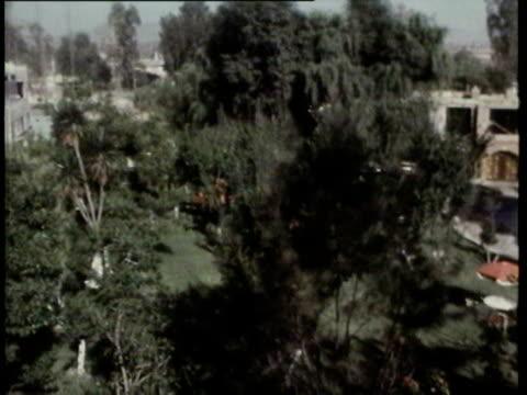 6may1970 montage england arrival in mexico peter bonetti bobby moore alan ball geoff hurst relaxing at hotel / mexico - butiksskylt bildbanksvideor och videomaterial från bakom kulisserna