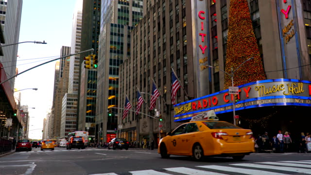 6th avenue and radio city music hall - radio city music hall stock videos & royalty-free footage