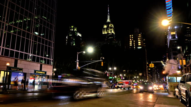 6th avenue. starbucks. empire state building - avenue stock videos & royalty-free footage