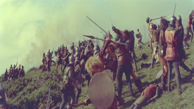 6th century crowd of knights with swords fight with peasants / knights of the round table (1954) - battle stock-videos und b-roll-filmmaterial