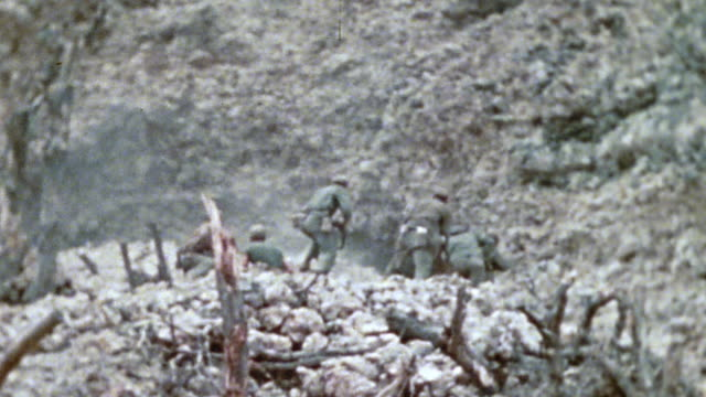 6th marine division infantry advancing up a hill under fire, throwing a hand grenade into a cave, dragging enemy casualty from cave, and removing his... - japan flag stock videos & royalty-free footage