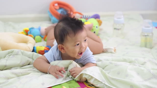 6th Month baby playing with toys