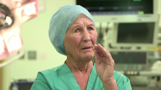 79yearold nurse lily hendry scotland glasgow int lily hendry along and chatting to patient in operating theatre sot lily hendry chatting to patient... - nhs stock videos & royalty-free footage