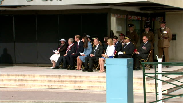 vídeos de stock, filmes e b-roll de 70th anniversary of dday landings arromanches ceremony clergywoman speaking at podium / william kate and others on stage listening - arromanches