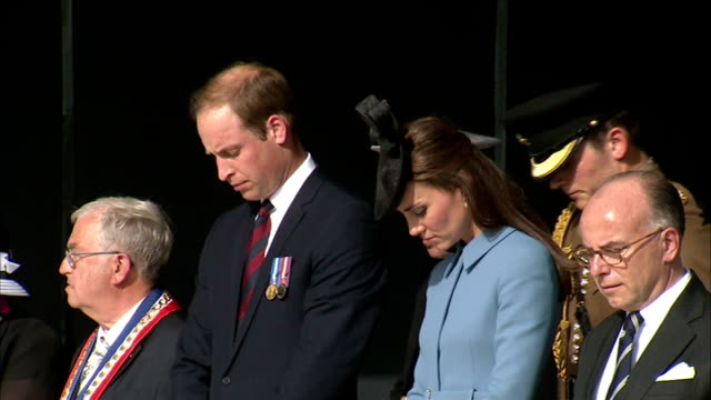 70th Anniversary of DDay landings Arromanches ceremony **Music heard intermittently SOT** William and Kate singing the national anthem / French...