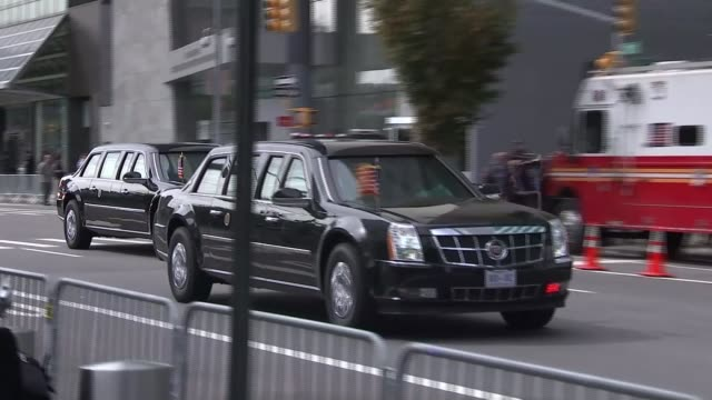issue of civil war in syria usa new york ext us presidential cortege along street un building close shot un flag side view of un building - 国際連合点の映像素材/bロール