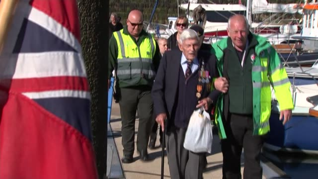 vídeos de stock e filmes b-roll de 75th anniversary of dunkirk flotilla of 'little ships' sets sail for france england kent ramsgate ext michael bentall along quayside with others /... - ramsgate