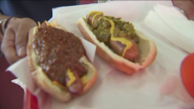 cent pink's hot dogs - hot pink stock videos and b-roll footage