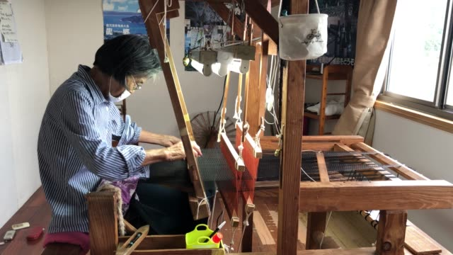 78yearold chieko kakino who has been weaving for 60 years operates her loom as she weaves a silk kimono at her workshop on july 16 2020 in tatsugo on... - 16 17 years stock videos & royalty-free footage