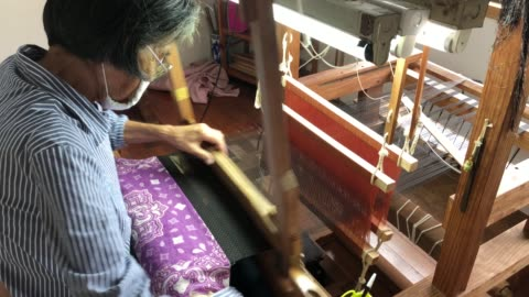year-old chieko kakino, who has been weaving for 60 years, operates her loom as she weaves a silk kimono at her workshop on july 16, 2020 in tatsugo... - 16 17 years stock videos & royalty-free footage