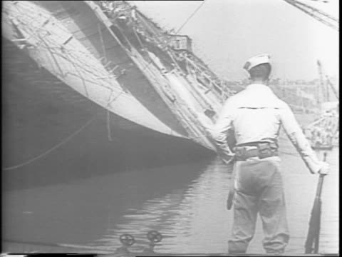 ton former luxury liner the normandie back on its feet / maiden voyage through disaster at pier 88 to successful salvage as a troop ship / a sailor... - former stock videos & royalty-free footage