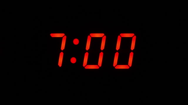 7am lcd digital alarm clock. Close up numbers only.