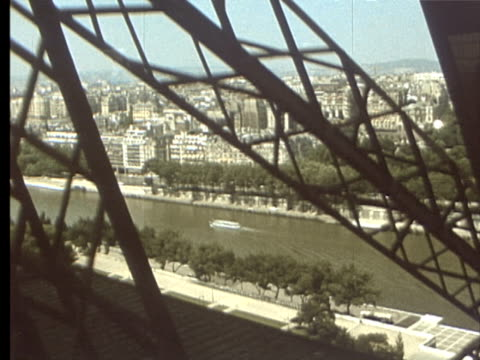 7jun1969 montage cityscape from eiffel tower / paris france - personal land vehicle stock videos & royalty-free footage