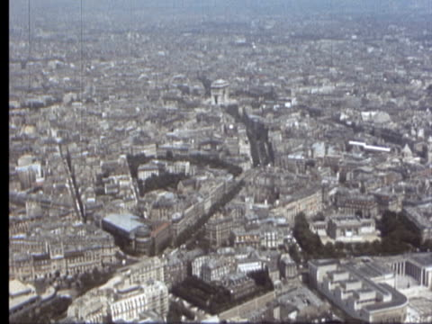 7jun1969 montage cityscape from eiffel tower / paris france - passenger craft stock videos & royalty-free footage