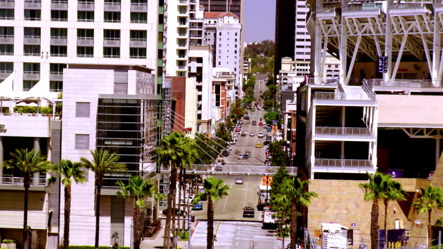 LS ZO 7th Avenue in Gaslamp Quarter to WS Omni Hotel across from Petco Stadium and San Diego Trolley train passing  / San Diego, California, USA