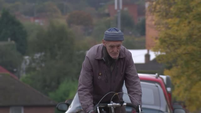 year-old cyclist russ mantle to be first brit to cycle one million miles; england: hampshire: aldershot: ext russ mantle getting on bicycle various... - offbeat stock videos & royalty-free footage
