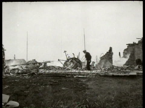8jul1940 b/w montage an english raf bomber has crashed into a row of houses in haarlem germans search the remains of the plane and houses / haarlem... - wrack stock-videos und b-roll-filmmaterial