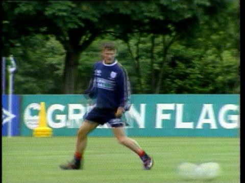 jun-1998 montage scottish team train and scottish fans in france; england team training in bisham abbey including alan shearer and teddy sheringham;... - one mid adult man only stock videos & royalty-free footage