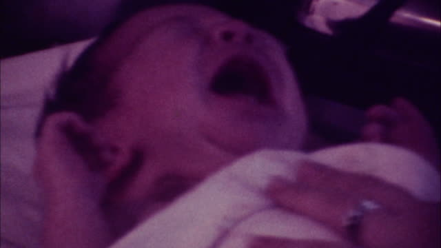 8mm footage - 70's- infant crying while being bathed - new life stock videos & royalty-free footage