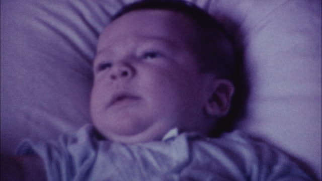 stockvideo's en b-roll-footage met 8mm footage - mother with newborn baby 70's - retro style