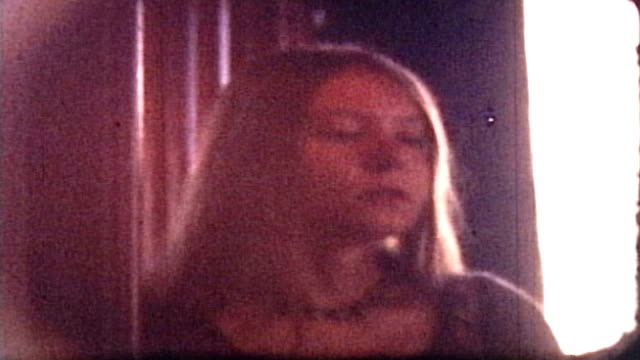 8mm footage of a young woman's pensive face. - 20 24 years stock videos & royalty-free footage