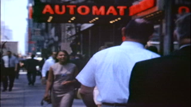 8mm shot of two teenage girls walking a street in 1960's Manhattan Automat.