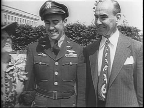 8th air force captains john godfrey and don gentile reunite with families on steps of the pentagon building / godfrey posing for pictures with... - pilot stock videos & royalty-free footage