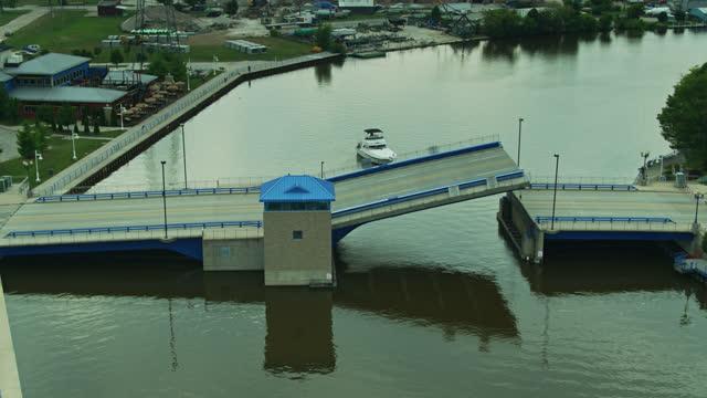 8th street bascule bridge raising in sheboygan - drone shot - bascule bridge stock videos & royalty-free footage