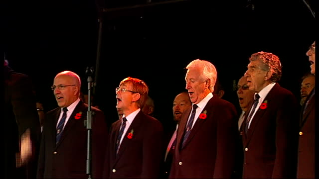 90th anniversary of armistice day remembrance day commemorations england london trafalgar square ext rolf harris singing 'two little boys' on stage... - remembrance day stock videos & royalty-free footage