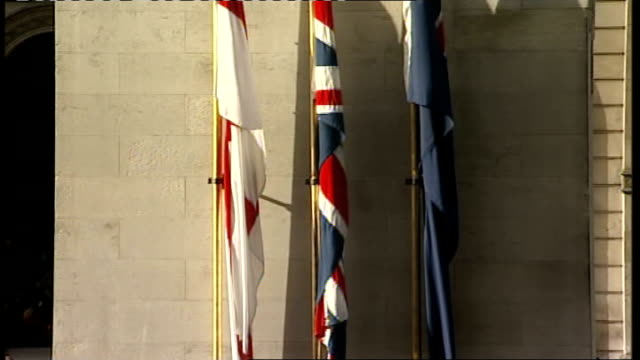 90th anniversary of armistice day remembrance day commemorations england london whitehall ext members of armed forces / flags hanging from cenotaph /... - remembrance day stock videos and b-roll footage