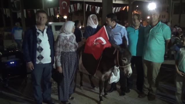 90yearold Emine Ozcan attends a demonstration on the back of a donkey to protest the failed military coup attempt by Gulenist Terror...