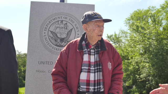 a 94year old wwii navy veteran stands inside a war memorial dedicated during memorial day ceremonies at valhalla memory gardens may 29 2017 in... - veterans of foreign wars of the united states stock videos & royalty-free footage