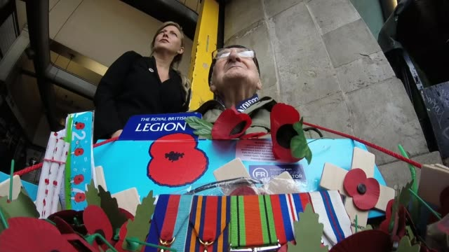 97yearold veteran bill champion sells poppies ahead of remembrance day uk london tooting broadway station bill champion selling poppies to people and... - poppy stock videos & royalty-free footage