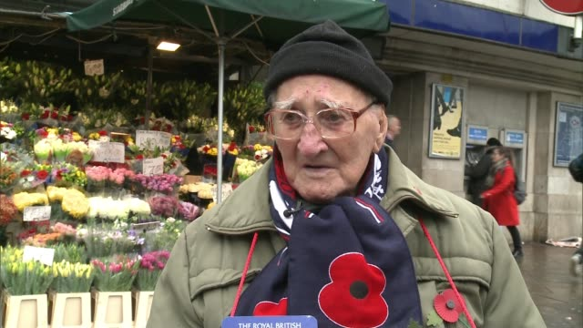 97yearold war veteran sells poppies in run up to remembrance day england london ext bill champion interview sot - remembrance day stock videos and b-roll footage