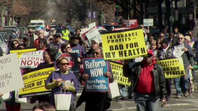 mar-2010 montage health care reform demonstration protest march to hotel where insurers were holding conference / washington dc, usa / audio - 2010 stock videos & royalty-free footage