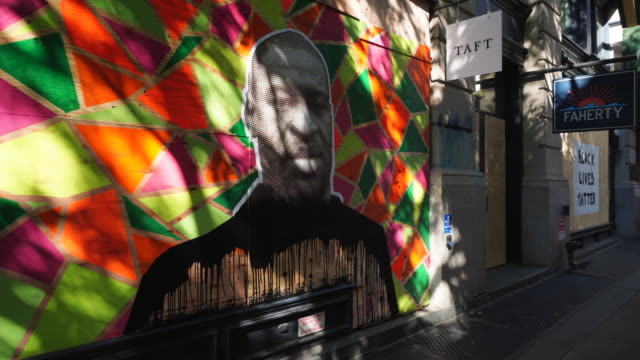 artists paint murals to protest george floyd's murder on store fronts in new york city stores have been boarded up to protect against potential mob... - mural stock videos & royalty-free footage