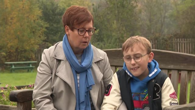 stockvideo's en b-roll-footage met 9yearold schoolboy tobias weller raises 150000 pounds for charity england yorkshire sheffield ext various of tobias weller who has cerebral palsy and... - grote hersenen